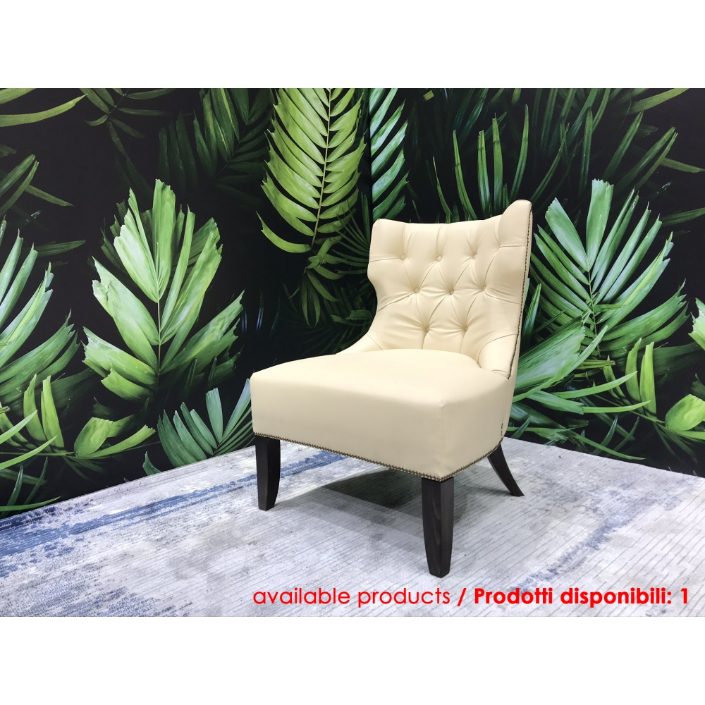 TUFTED BACK LOUNGE ARMCHAIR with wenghè varnished wooden base and leather upholstery
